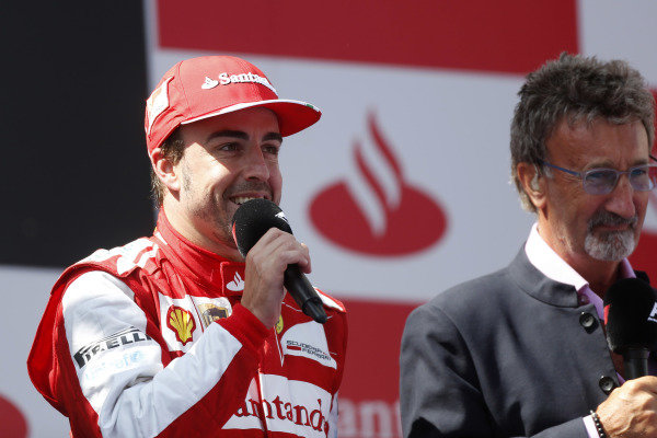 Circuit de Catalunya, Barcelona, Spain 12th May 2013 Eddie Jordan, BBC F1 TV Pundit, interviews Fernando Alonso, Ferrari, 1st position, on the podium. Photo: Andrew Ferraro/LAT Photographic ref: Digital Image _79P6157