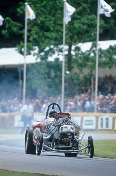 """2004 Goodwood Festival of SpeedGoodwood House, Chichester, England. 25th - 27th June.Ron Hope at the wheel of the infamous US dragster, the """"Rat Trap""""World Copyright: Peter Spinney/LAT Photographicref: 35mm Transparency Image."""