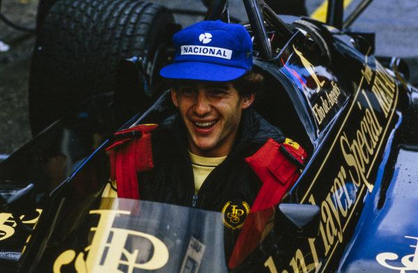 Ayrton Senna, sat in teammate Elio de Angelis's Lotus 97T Renault.