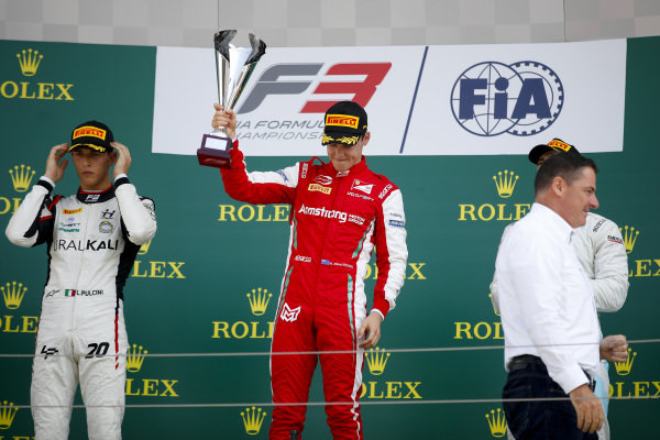 HUNGARORING, HUNGARY - AUGUST 04: Leonardo Pulcini (ITA) Hitech Grand Prix, Race winner Marcus Armstrong (NZL) PREMA Racing and Jake Hughes (GBR) HWA RACELAB celebrate on the podium with the trophy during the Hungaroring at Hungaroring on August 04, 2019 in Hungaroring, Hungary. (Photo by Joe Portlock / LAT Images / FIA F3 Championship)