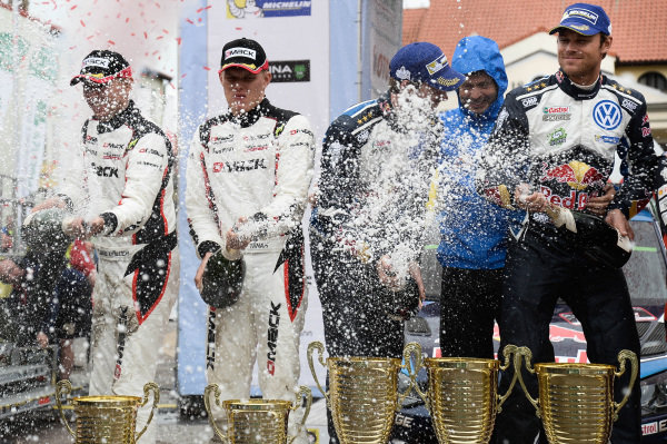 Second placed Ott Tanak (EST) / Raigo Molder (EST), Drive DMACK World Rally Team WRC and winners Andreas Mikkelsen (NOR) / Anders Jaeger Synnevag (NOR), Volkswagen Motorsport II WRC celebrate on the podium with the champagne at FIA World Rally Championship, Rd7, Rally Poland, Day Three, Mikolajki, Poland, 3 July 2016.