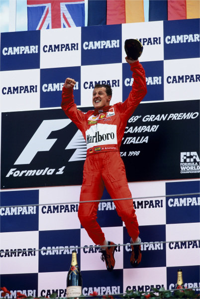 2003 Racing Past... Exhibition 1998 Italian Grand Prix, Monza. Michael Schumacher jumps for joy after winning his second Italian race. World Copyright - LAT Photographic Exhibition ref: a040