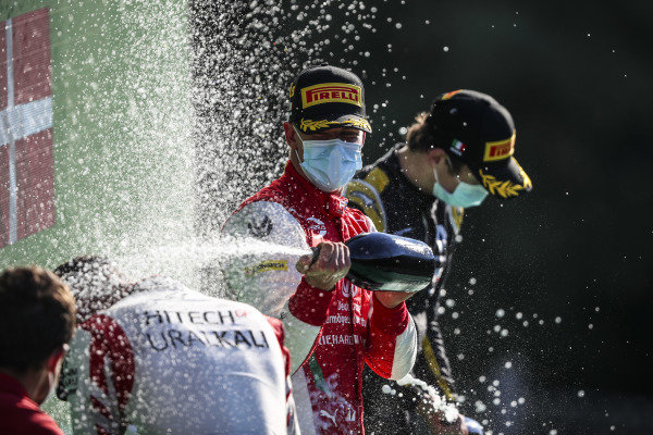 Luca Ghiotto (ITA, HITECH GRAND PRIX), Race Winner Mick Schumacher (DEU, PREMA RACING) and Christian Lundgaard (DNK, ART GRAND PRIX) celebrate on the podium with the champagne