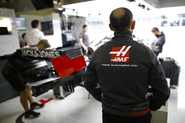 Haas mechanics at work in the team's garage.