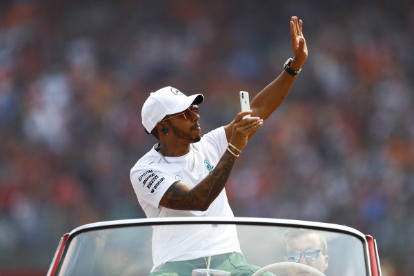 Lewis Hamilton, Mercedes AMG F1, waves to fans on the drivers' parade.
