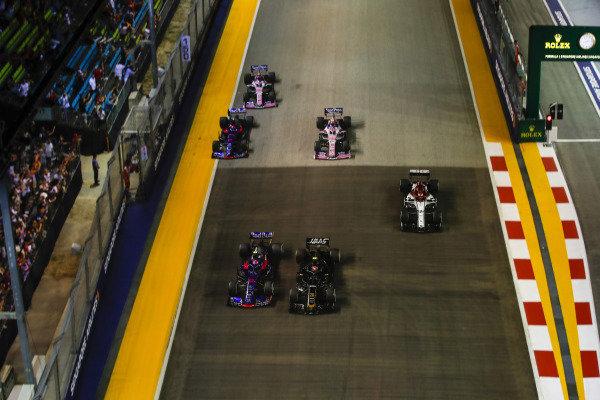 Pierre Gasly, Toro Rosso STR14, battles with Kevin Magnussen, Haas VF-19, ahead of Kimi Raikkonen, Alfa Romeo Racing C38, Daniil Kvyat, Toro Rosso STR14, Sergio Perez, Racing Point RP19, and Lance Stroll, Racing Point RP19