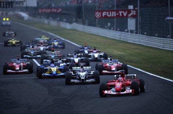 Rubens Barrichello, Ferrari F2003-GA, leads Juan Pablo Montoya, Williams FW25 BMW, Fernando Alonso, Renault R23B, Cristiano da Matta, Toyota TF103, David Coulthard, McLaren MP4-17D Mercedes, Olivier Panis, Toyota TF103, and Kimi Räikkönen, McLaren MP4-17D Mercedes, at the start.