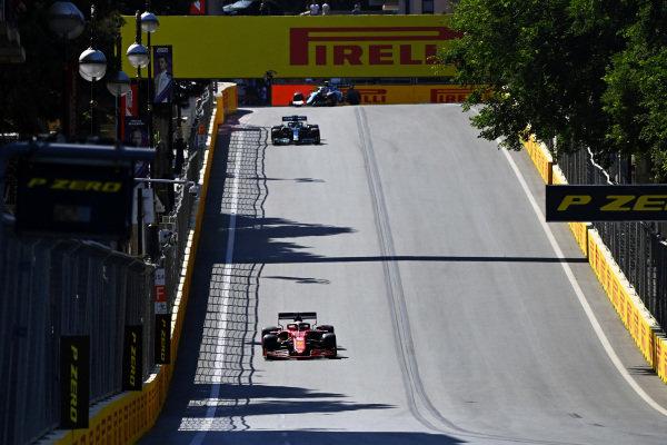 Charles Leclerc, Ferrari SF21, leads Lance Stroll, Aston Martin AMR21