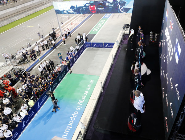 Max Verstappen, Red Bull Racing, 2nd position, Sir Lewis Hamilton, Mercedes, 1st position, and Valtteri Bottas, Mercedes, 3rd position, on the podium, with their teams gathered beneath