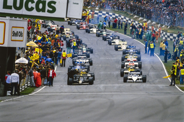 Ayrton Senna, Lotus 97T Renault, and Nelson Piquet, Brabham BT54 BMW, prepare to lead the field on the formation lap.