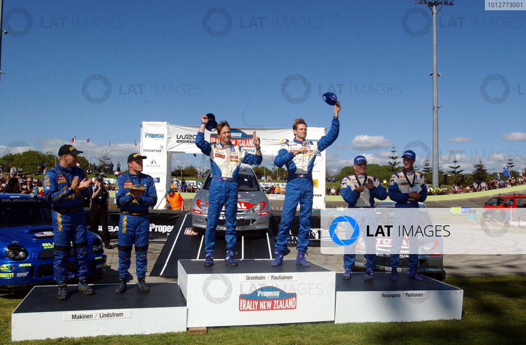 2002 World Rally Championship.Propecia Rally of New Zealand, Auckland, October 3rd-6th.The top three crews, all Finnish, on the Podium.Photo: Ralph Hardwick/LAT