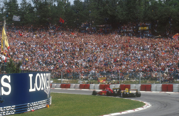 1990 San Marino Grand Prix.Imola, Italy.11-13 May 1990.Riccardo Patrese (Williams FW13B Renault) lines up Nigel Mansell (Ferrari 641) for a pass to take 2nd place.Ref-90 SM 19.World Copyright - LAT Photographic
