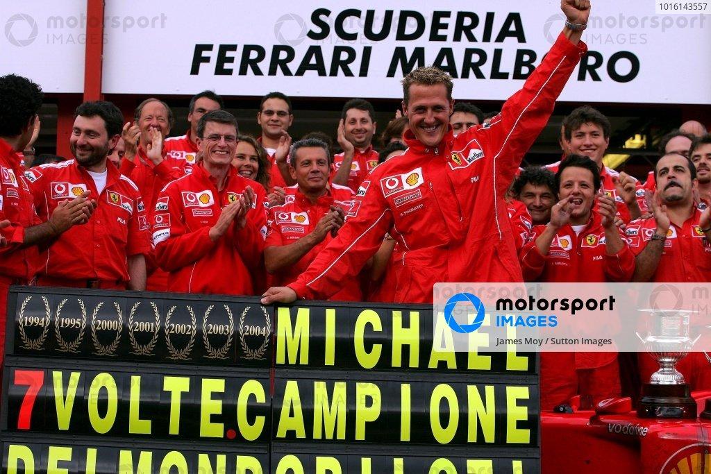 Michael Schumacher (GER) Ferrari celebrates winning his seventh World Drivers Championship with his Ferrari team mates. Formula One World Championship, Rd14, Belgian Grand Prix, Race Day, Spa Francorchamps, Belgium, 29 August 2004. DIGITAL IMAGE  BEST IMAGE