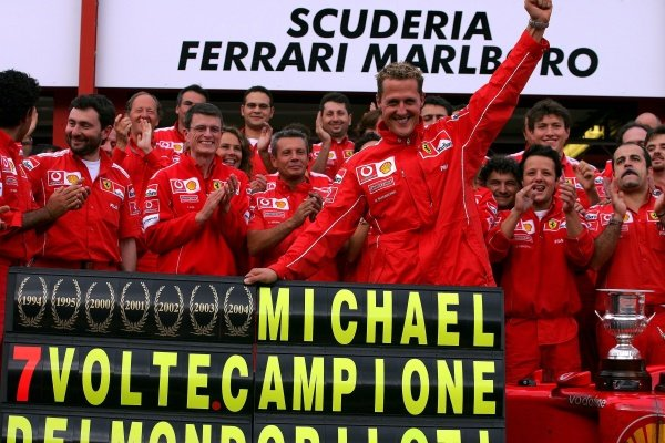 Michael Schumacher (GER) Ferrari celebrates winning his seventh World Drivers Championship with his Ferrari team mates. Formula One World Championship, Rd14, Belgian Grand Prix, Race Day, Spa Francorchamps, Belgium, 29 August 2004. DIGITAL IMAGE  BEST IMAGE