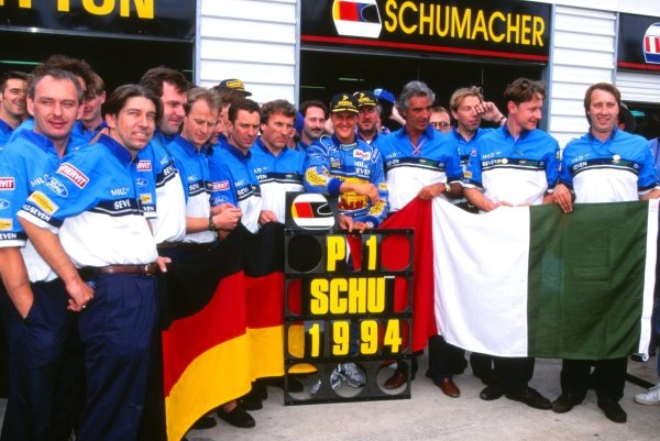 Michael Schumacher (GER) celebrates his World Championship with the Benetton Team and Michael Jakeman (GBR) (far right)