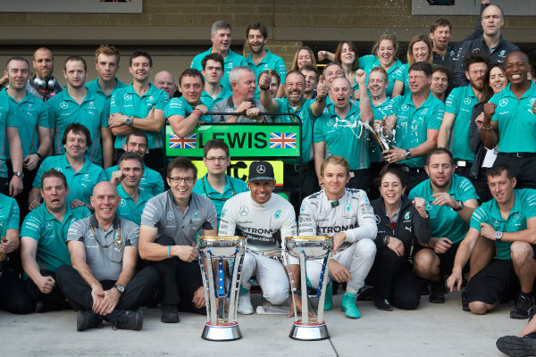 Circuit of the Americas, Austin, Texas, United States of America. Sunday 2 November 2014. Lewis Hamilton, Mercedes AMG celebrates with the team and Nico Rosberg, Mercedes AMG after winning the race. World Copyright: Steve Etherington/LAT Photographic. ref: Digital Image SNE25050