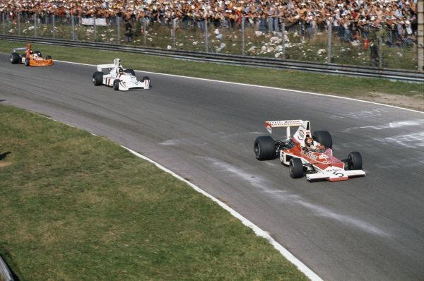 1974 Italian Grand Prix.  Monza, Italy. 6-8th September 1974.  Emerson Fittipaldi, McLaren M23 Ford, leads James Hunt, Hesketh 308 Ford, and Vittorio Brambilla, March 741 Ford, into Parabolica.  Ref: 74ITA04. World Copyright: LAT Photographic