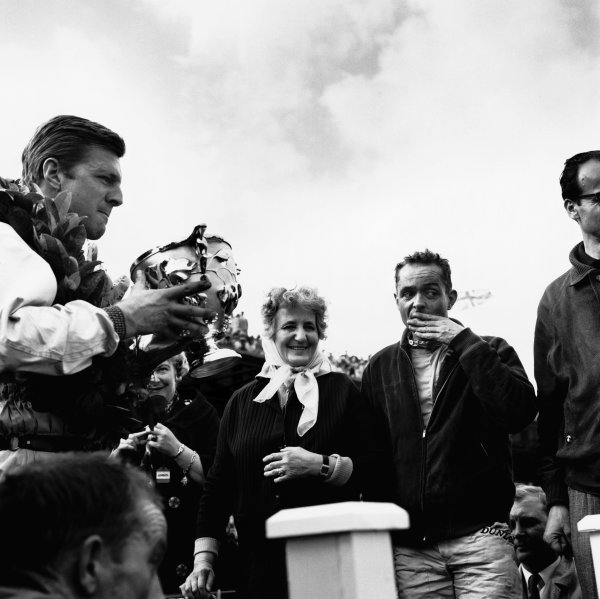 Aintree, Great Britain. 13th -15th July 1961.Laura Ferrari, wife of Enzo Ferrari, presents the winners trophy to Wolfgang von Trips (Ferrari 156) 1st position, with team mate Phil Hill (Ferrari 156) 2nd position, just behind, portrait.World Copyright - LAT Photographic.ref: 10060