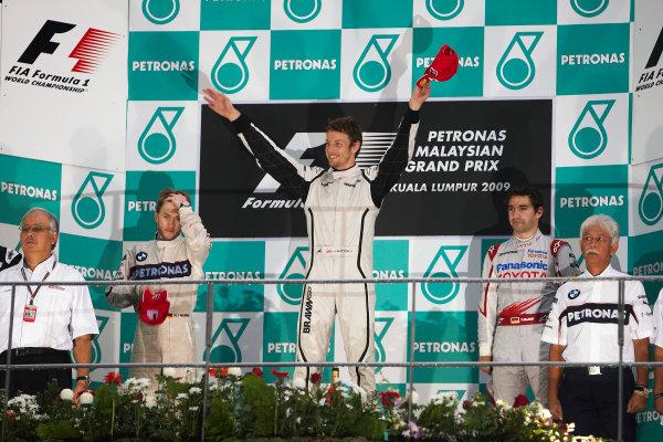 Sepang, Kuala Lumpur, Malaysia 5th April 2009 Jenson Button, Brawn GP BGP001 Mercedes, 1st position, Nick Heidfeld, BMW Sauber F1.09, 2nd position, and Timo Glock, Toyota TF109, 3rd position, on the podium. Portrait. Podium.  World Copyright: Steve Etherington/LAT Photographic ref: Digital Image SNE15030