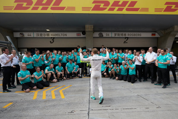Shanghai International Circuit, Shanghai, China. Sunday 17 April 2016. Nico Rosberg, Mercedes AMG, 1st Position, and the Mercedes team celebrate victory after the race. World Copyright: Steve Etherington/LAT Photographic ref: Digital Image SNE21999