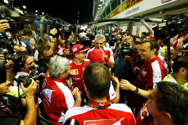 Marina Bay Circuit, Singapore. Sunday 20 September 2015. Sebastian Vettel, Ferrari, 1st Position, Kimi Raikkonen, Ferrari, 3rd Position, and the Ferrari team celebrate a double podium result. World Copyright: Alastair Staley/LAT Photographic ref: Digital Image _R6T7580