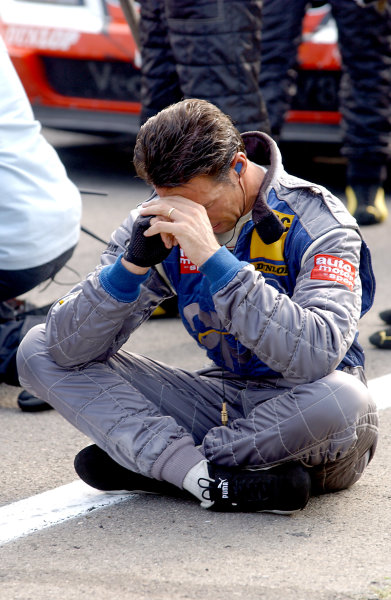 2004 DTM ChampionshipZandvoort, Netherlands. 4th - 5th September.Manuel Reuter (OPC Holzer Opel Vectra GTS) ponders the possible consequences of Peter Dumbreck's accident as the paddock waits for news of his condition. Portrait. World Copyright: Andre Irlmeier/LAT Photographicref: Digital Image Only