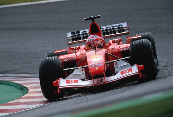 2003 Japanese Grand PrixSuzuka, Japan. 10th - 112th October 2003.Race winner Rubens Barrichello, Ferrari F2003 GA, action.World Copyright: Lorenzo Bellanca / LAT Photographic ref: 35mm Image 03JAP02