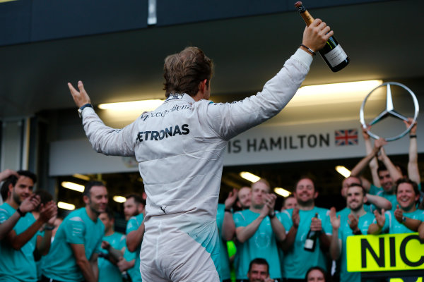 Baku City Circuit, Baku, Azerbaijan. Sunday 19 June 2016. Nico Rosberg, Mercedes AMG celebrates with a bottle of champagne and his team. World Copyright: Andrew Hone/LAT Photographic ref: Digital Image _ONY1871