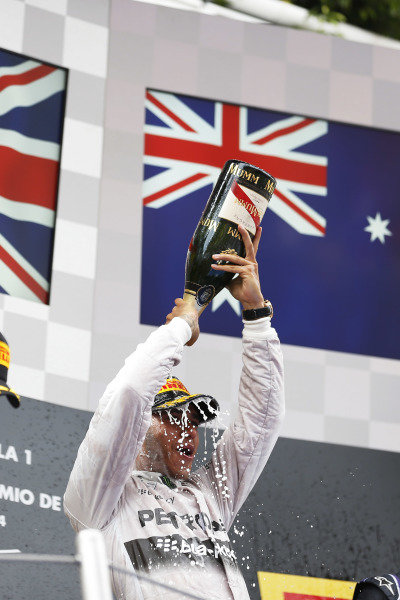 Circuit de Catalunya, Barcelona, Spain. Sunday 11 May 2014. Lewis Hamilton, Mercedes AMG, 1st Position, pours Champagne over his head in celebration. World Copyright: Sam Bloxham/LAT Photographic. ref: Digital Image _SBL8947