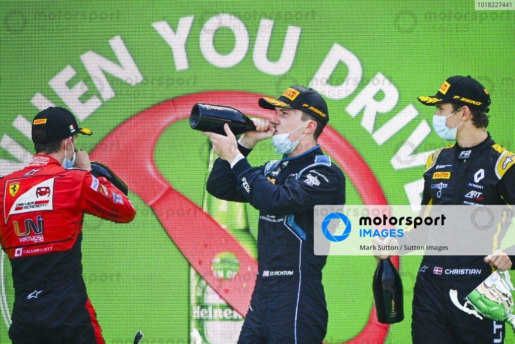 Callum Ilott (GBR, UNI-VIRTUOSI), Race winner Dan Ticktum (GBR, DAMS) and Christian Lundgaard (DNK, ART GRAND PRIX) celebrate on the podium with the champagne