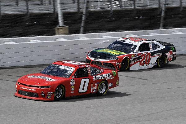 #0: Garrett Smithley, JD Motorsports, Chevrolet Camaro Victory Lane and #20: Christopher Bell, Joe Gibbs Racing, Toyota Supra Rheem / RTP
