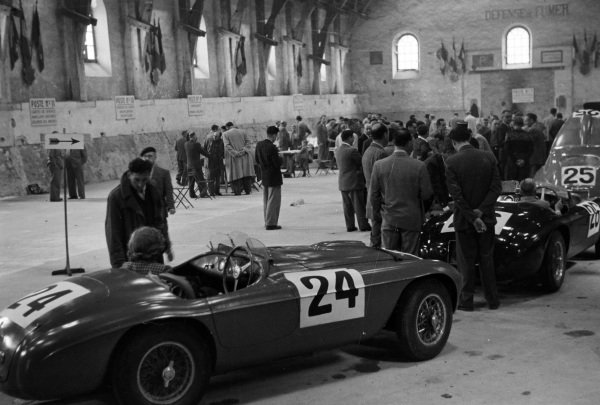 The Ferrari 195S Barchetta of Luigi Chinetti / Pierre Louis-Dreyfus (#25), behind the Ferrari 166 MM of Porfirio Rubirosa / Pierre Leygonie (#26), and the Ferrari 195S Berlinetta Touring of Raymond Sommer / Dorino Serafini, line up during scrutineering.