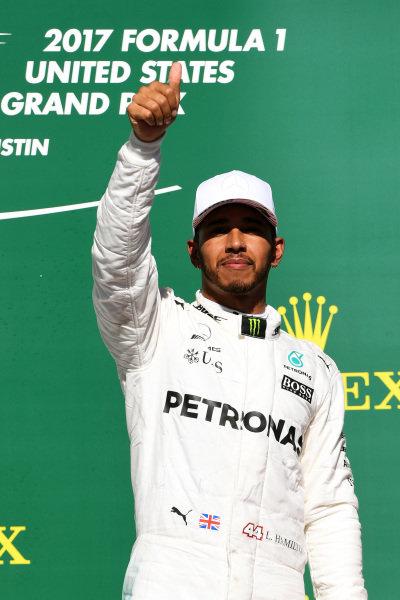 Race winner Lewis Hamilton (GBR) Mercedes AMG F1 celebrates on the podium at Formula One World Championship, Rd17, United States Grand Prix, Race, Circuit of the Americas, Austin, Texas, USA, Sunday 22 October 2017.