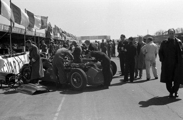 Mechanics work in the engine bay of Yves Giraud-Cabantous, Lago-Talbot T26C-DA, in the pits.