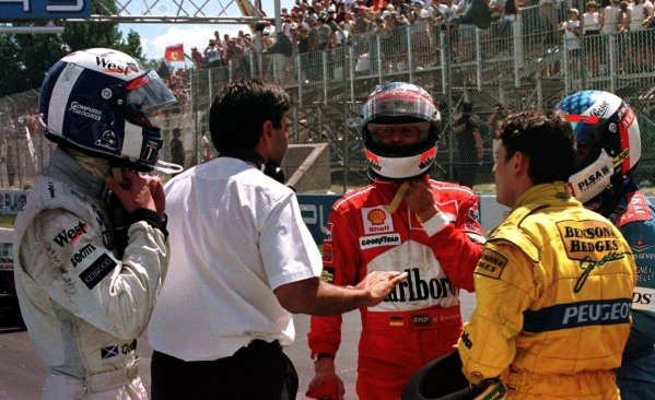 1997 Canadian Grand Prix.Montreal, Quebec, Canada.13-15 June 1997.The drivers gather on the grid after the race was stopped due to Olivier Panis's accident. (L-R) David Coulthard (McLaren Mercedes-Benz), Michael Schumacher (Ferrari), Giancarlo Fisichella (Jordan Peugeot) and Jean Alesi (Benetton Renault). They finished in 7th, 1st, 3rd and 2nd positions respectively.World Copyright - LAT Photographic