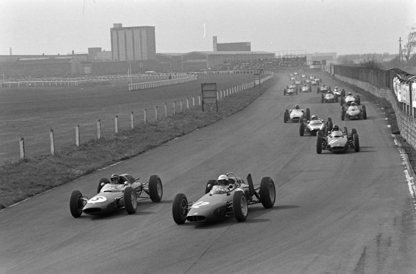 Richie Ginther, BRM P578 leads Jim Clark, Lotus 24 Climax and Graham Hill, BRM P578 at the start.