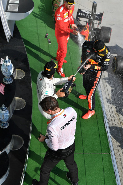 Lewis Hamilton, Mercedes AMG F1, 1st position, sprays Champagne at Max Verstappen, Red Bull Racing, 2nd position