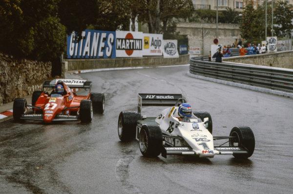 Keke Rosberg, Williams FW08C Ford, leads Patrick Tambay, Ferrari 126C2B.