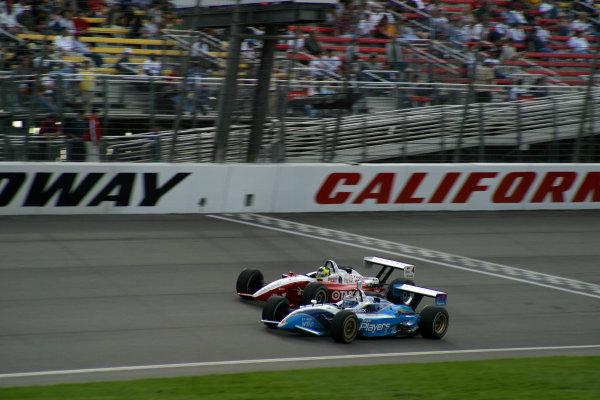 2002 Fontana CART, California Speedway, USA, 3 November, 2002Tagliani races with Junqueira-2002, Michael L. Levitt, USALAT Photographic