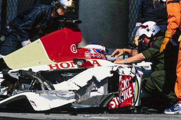 Jenson Button, BAR 005 Honda, suffers a massive crash. Marshals and medics attend the scene.