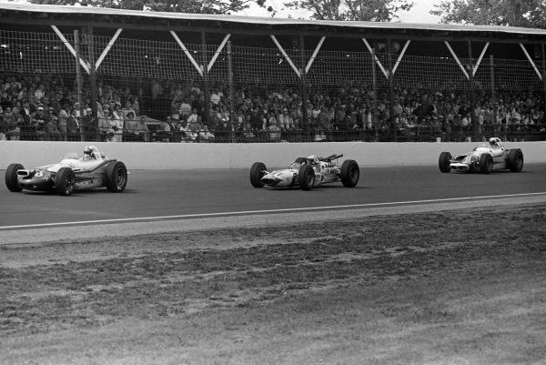 Parnelli Jones, J. C. Agajanian, Watson Offenhauser, leads Bobby Marshman, Lindsey Hopkins, Lotus 34 Ford, and A. J. Foyt, Ansted-Thompson Racing, Watson Offenhauser.