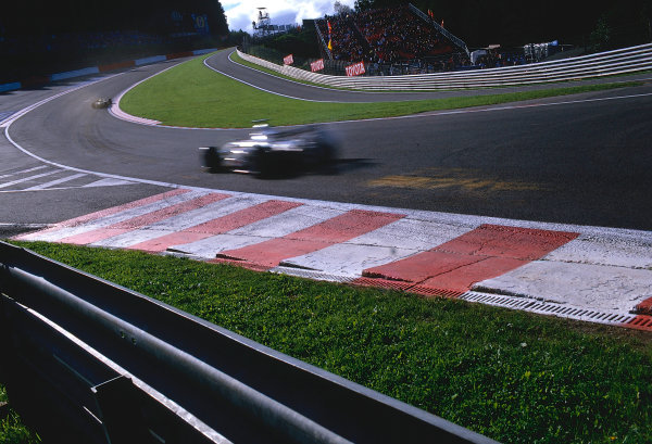 2002 Belgian Grand Prix.Spa-Francorchamps, Belgium. 30/8-1/9 2002.Cars fly through the newly revised Eau Rouge flat out. Patches are left where the wooden planks scrape the track surface.Ref-02 BEL 13.World Copyright - Tee/LAT Photographic