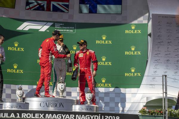 Sebastian Vettel (GER) Ferrari, Lewis Hamilton (GBR) Mercedes-AMG F1 and Kimi Raikkonen (FIN) Ferrari celebrate on the podium with the champagne