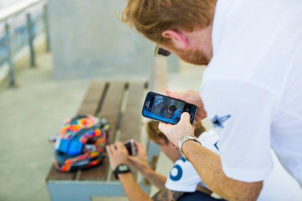 2017 FIA Formula 2 Round 11. Yas Marina Circuit, Abu Dhabi, United Arab Emirates. Thursday 23 November 2017. Artem Markelov (RUS, RUSSIAN TIME) is photographed taking a photo of his helmet Photo: Sam Bloxham/FIA Formula 2. ref: Digital Image _J6I0945