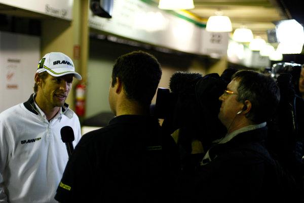 Interlagos, Sao Paulo, Brazil.17th October 2009.Jenson Button, Brawn GP BGP001 Mercedes, is interviewed outside the Brawn GP garage. Portrait. Media. World Copyright: Charles Coates/LAT Photographicref: Digital Image _26Y2491