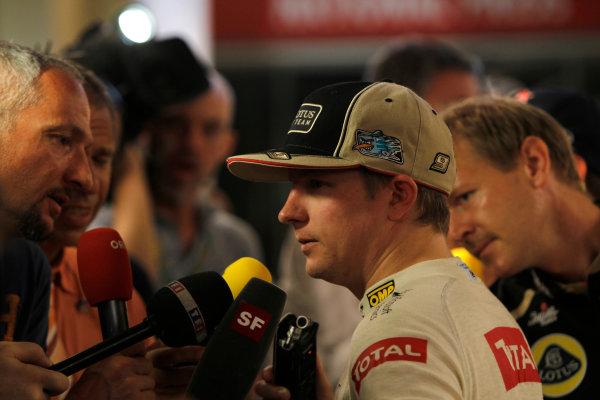 Yas Marina Circuit, Abu Dhabi, United Arab Emirates Sunday 4th November 2012. Kimi Raikkonen, Lotus GP, talks to the media after victory. World Copyright: Andrew Ferraro/  ref: Digital Image _Q0C2790