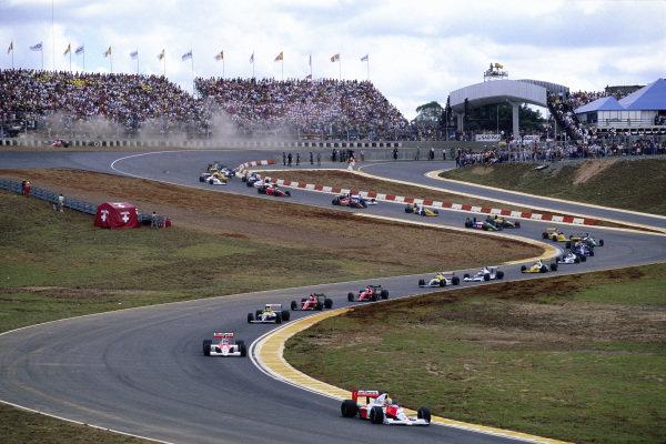 Ayrton Senna, McLaren MP4-5B Honda, leads as further back Andrea de Cesaris, Dallara BMS-190 Ford, goes off.