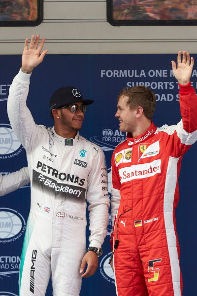 Shanghai International Circuit, Shanghai, China. Saturday 11 April 2015. Pole man Lewis Hamilton, Mercedes AMG, with Sebastian Vettel, Ferrari, who qualified third. World Copyright: Steve Etherington/LAT Photographic. ref: Digital Image SNE10528