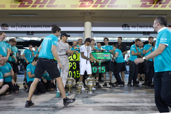 Bahrain International Circuit, Sakhir, Bahrain. Sunday 19 April 2015. Lewis Hamilton, Mercedes AMG, 1st Position, Nico Rosberg, Mercedes AMG, 3rd Position, and the Mercedes team celebrate victory. World Copyright: Steve Etherington/LAT Photographic. ref: Digital Image SNE24534