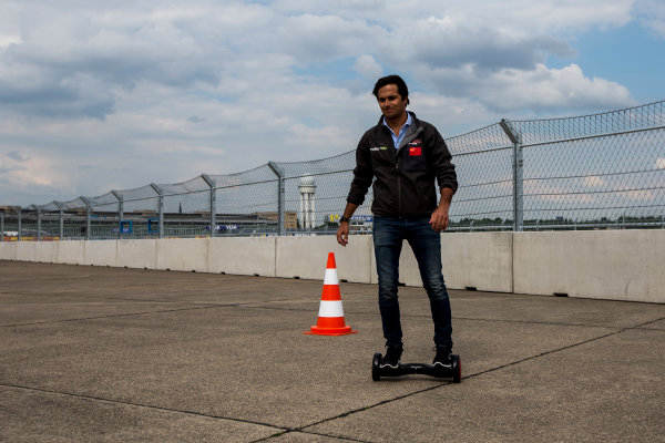 2014/2015 FIA Formula E Championship. Berlin ePrix, Berlin Tempelhof Airport, Germany. Thursday 21 May 2015Nelson Piquet Jr (BRA)/China Racing - Spark-Renault SRT_01E on a hovertrax. Photo: Zak Mauger/LAT/Formula E ref: Digital Image _L0U6559